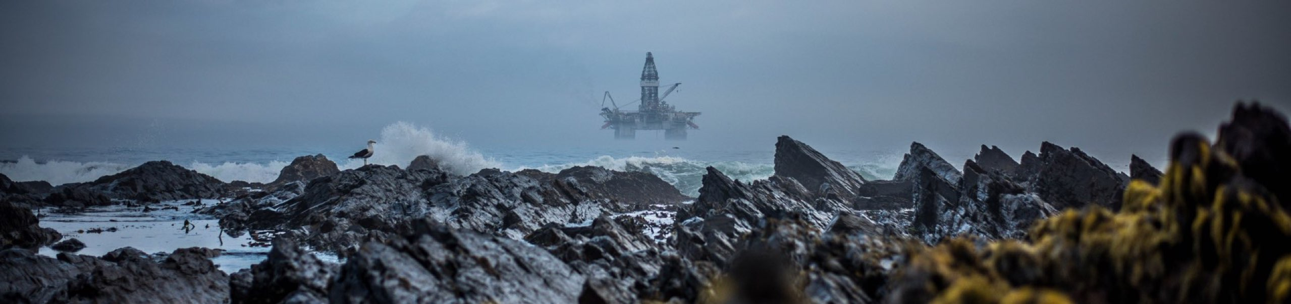Rocky beach with an Oilrig in the view